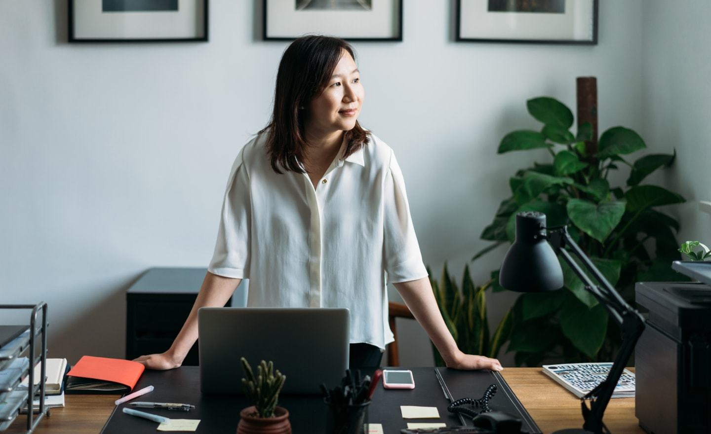 Asian woman at desk looking right