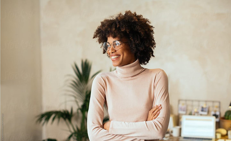 Black woman in turtleneck looking left