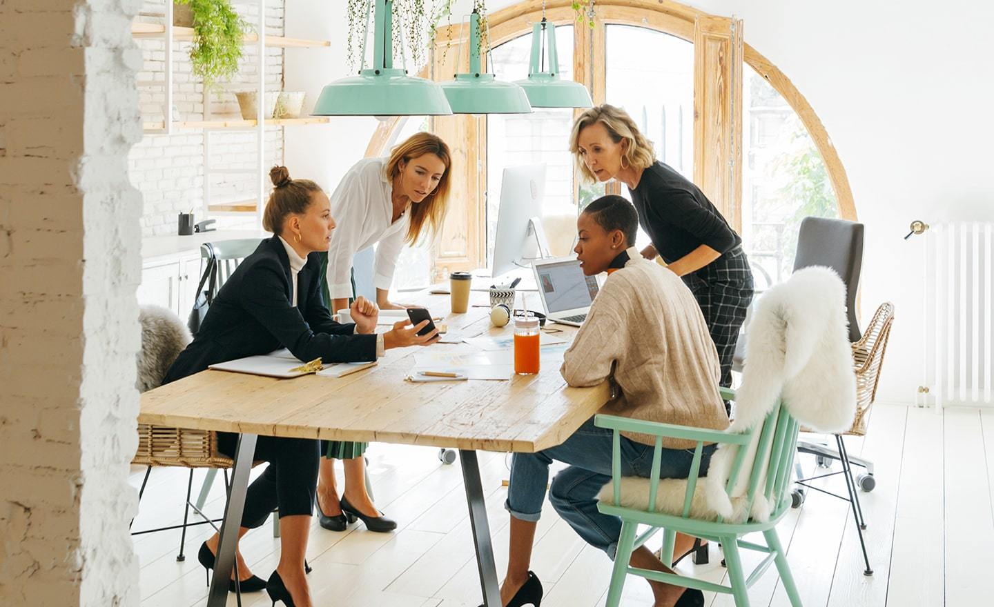 Group of female coworkers at a shared desk