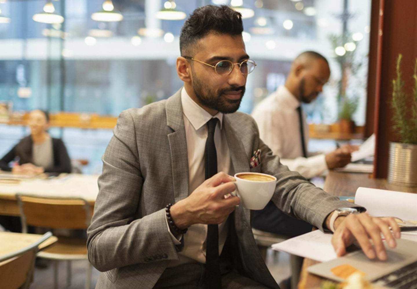 Man in a suit drinking coffee