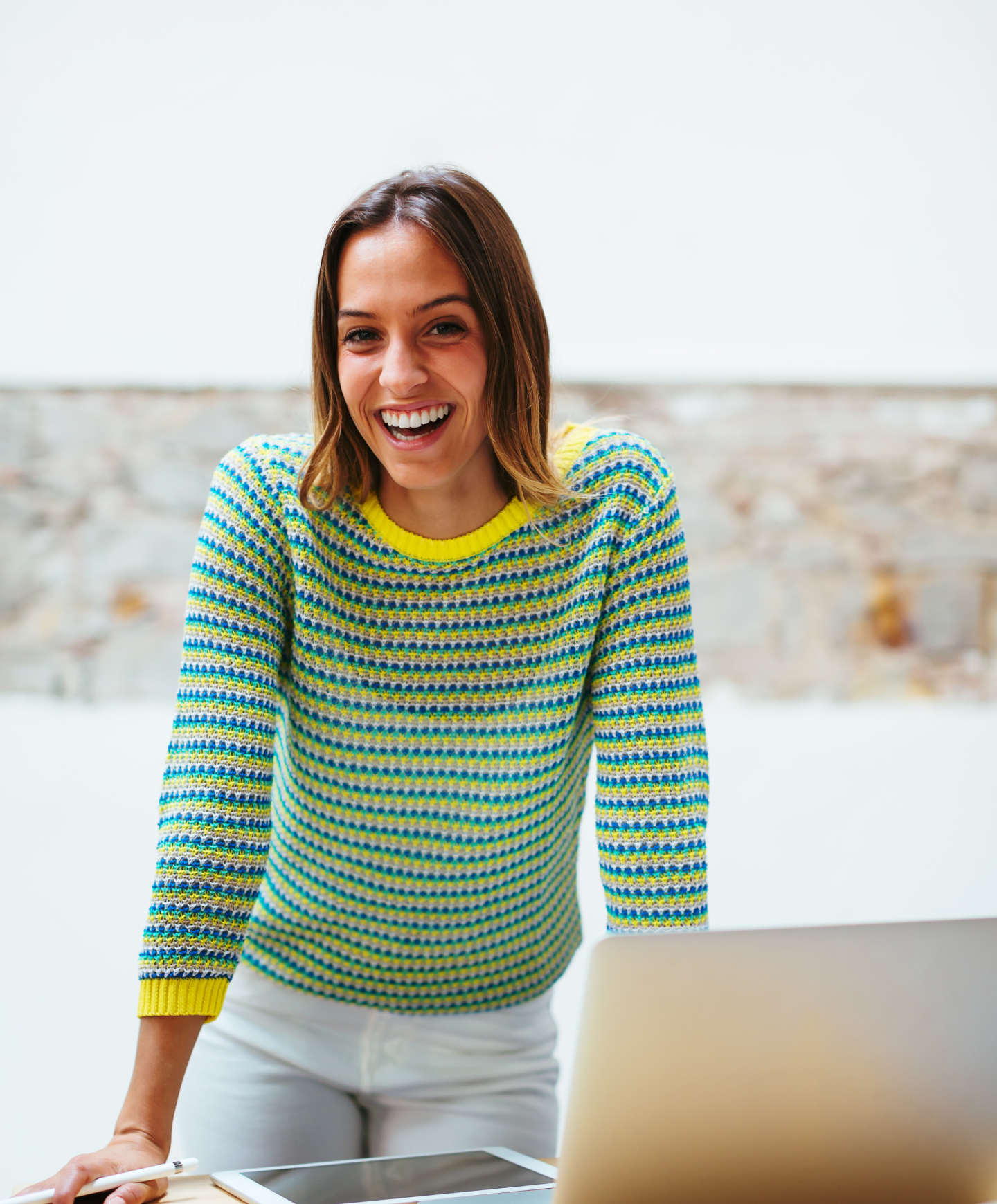 Photo of a smiling woman in a striped sweater