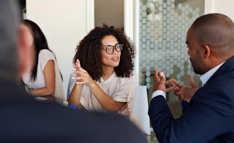 Two coworkers talking in meeting