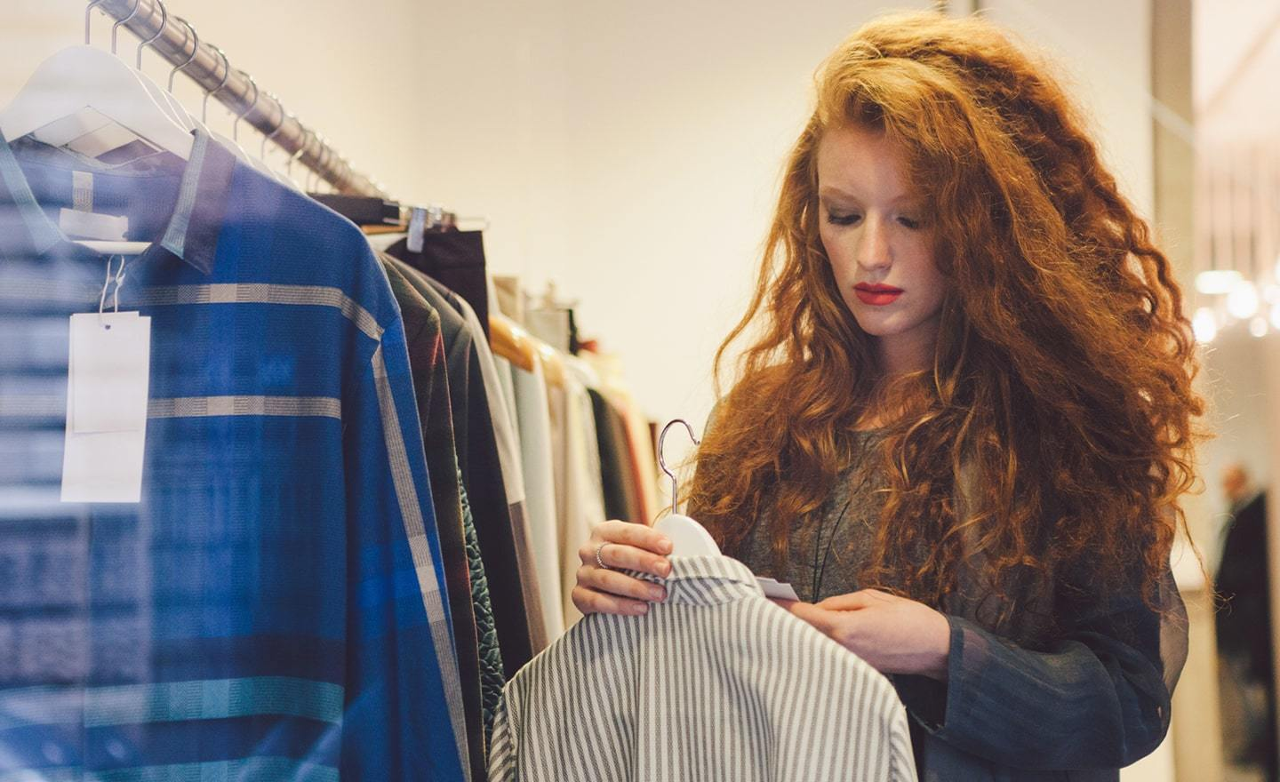 Wardrobe stylist looking at sweater