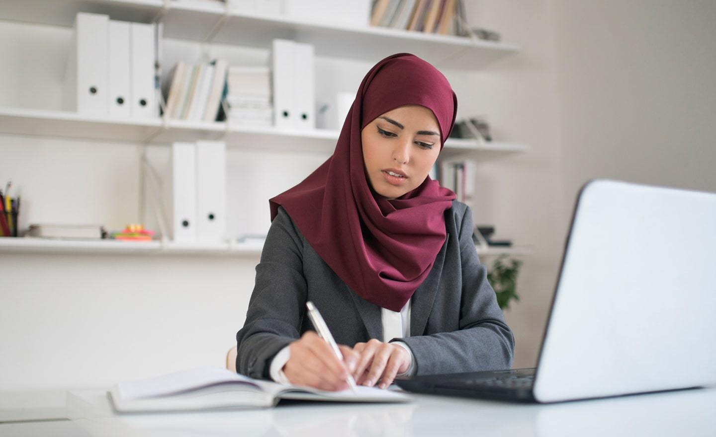 Woman in a hijab at her desk