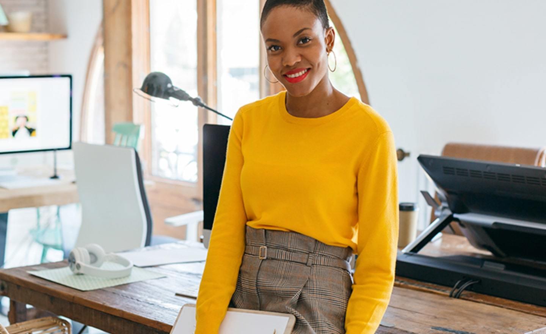 Woman in bright yellow sweater