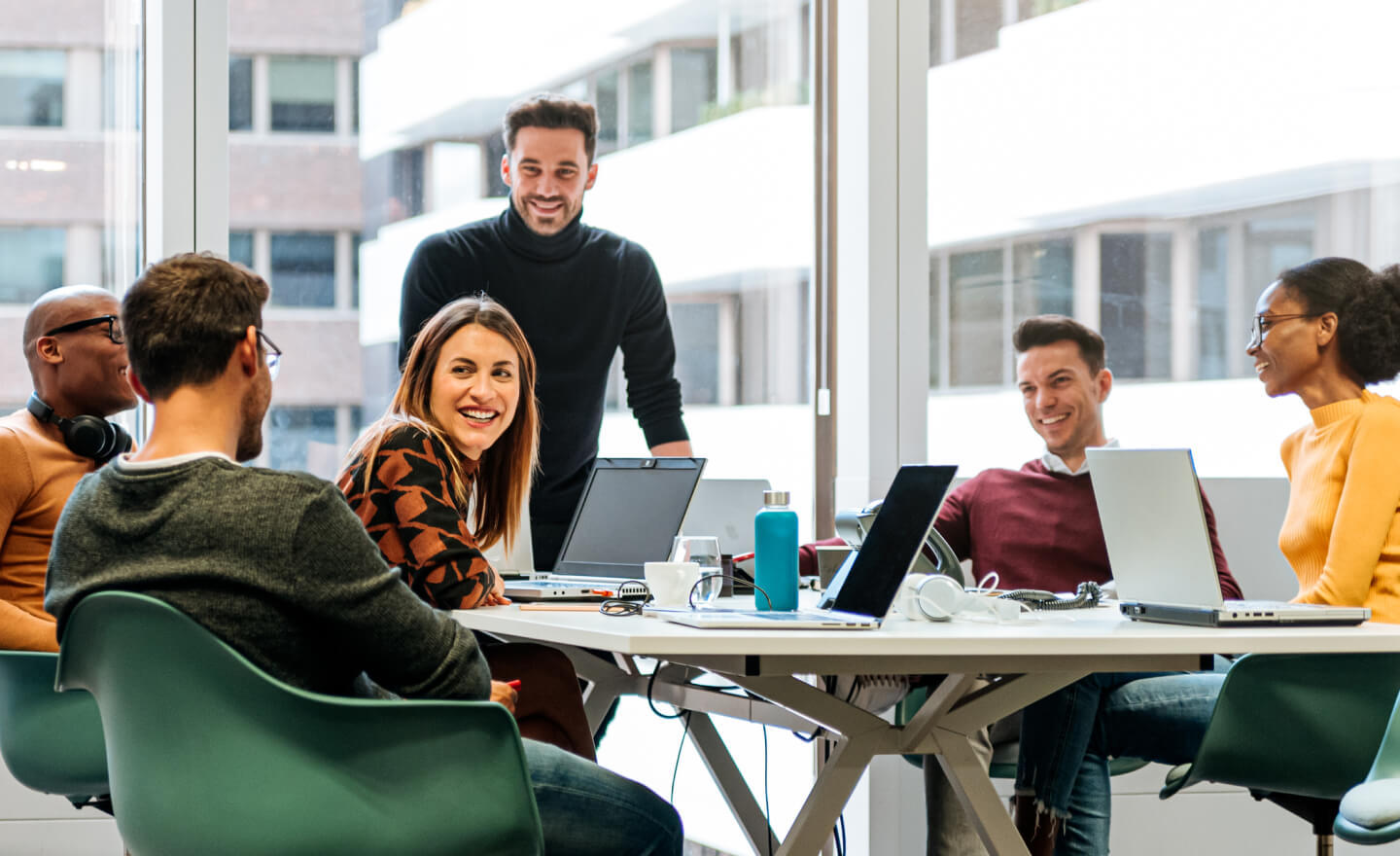 Group of coworkers around a conference table in a corporate office