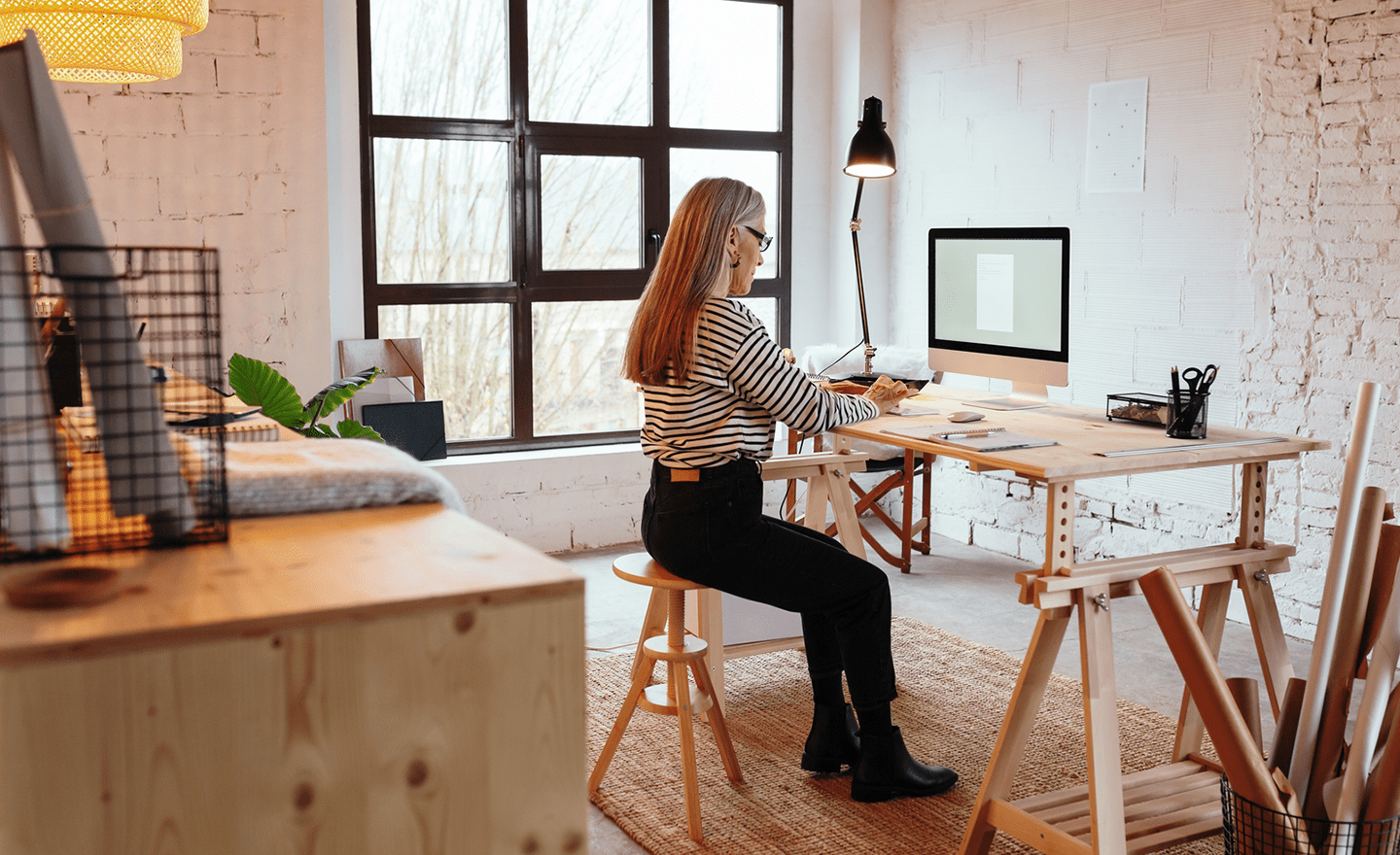 Professional woman working on computer in office