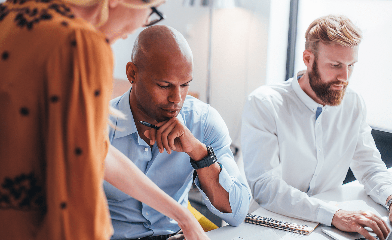 Team reviewing hiring data 1