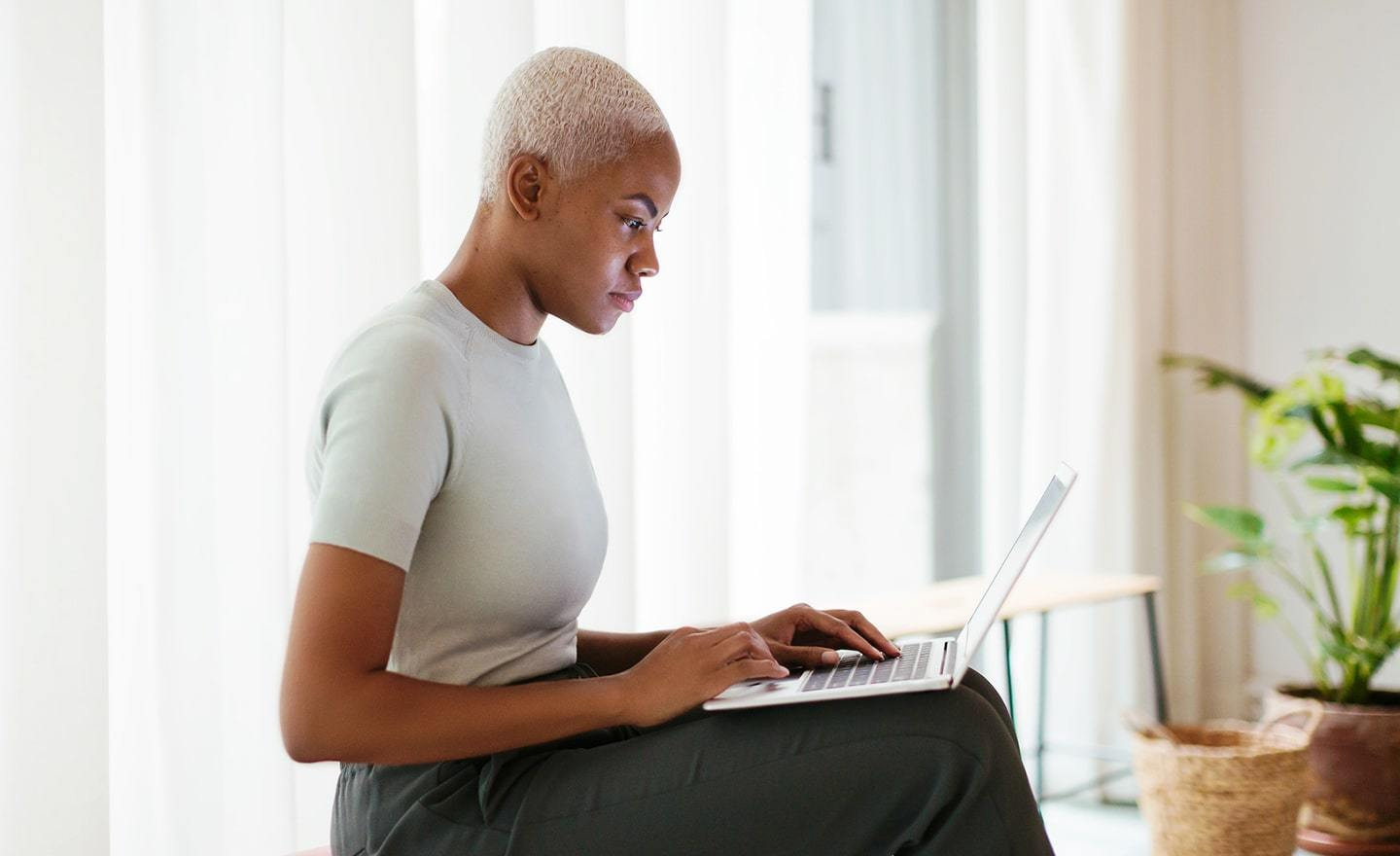 Woman reviewing work on laptop